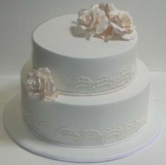 Two tier Ivory Roses and lace wedding cake