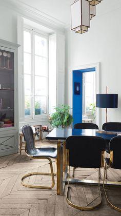 Jean-Christophe Aumas' multihued Paris apartment | Vintage leather dining chairs.