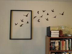 decorating idea: artwork entering/exiting frame. Interesting.  P.