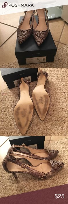 """Cole Haan Kyle Cut Out Pump Roccia Snake Print Lovingly worn. Uppers in excellent condition. Pointed toe. Cutout sides. Adjustable buckle closures. Lightly cushioned footbed. Covered mid stiletto 3"""" heel. Original box. No dust bag. No trades. Cole Haan Shoes Heels"""