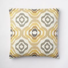This will help tie in the modern & bamboo shades. Floral Ikat Pillow Cover - Buttercup WestElm.com
