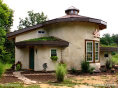 Lotus Cottage in West Virginia, USA has a rubble trench foundation with exterior straw bale walls plastered with lime outside and clay inside. All the timber was locally grown and lots of salvaged parts like windows were used in the building. See the construction steps at www.naturalhomes.org/beths-strawbale-cottage.htm