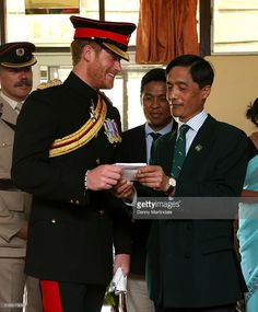 Prince Harry meets Bishnukunr Pun a Gurkha who he took him around Salisbury Plain when he was 6 years old with his father shows him a picture of the event at British Gurkha Camp on March 22, 2016 in Pokhara, Nepal.