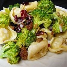 Broccoli and Tortellini Salad | Broccoli keeps very good company in this wonderful salad. There's fresh cheese tortellini, bacon, raisins, sunflower seeds, broccoli florets, red onion, and a sweet and sour mayonnaise dressing tossed in for good measure.