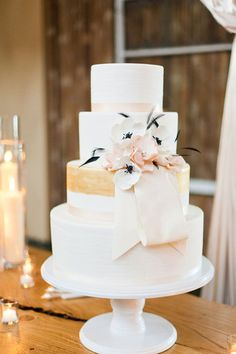 10 Extraordinary Wedding Cake Designs. - - 6. Blush and Gold Wedding Cake  If this cake tastes as sweet as it looks, then I'm sold. The muted tones and sash create an angelic feel.