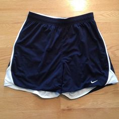 Nike Navy Blue and White Reversible Shorts These shorts are gently used. They are reversible from navy blue to white. Have a tie for extra support! Nike Shorts
