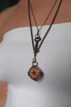 Vintage mosaic and padlock key necklace. via Etsy