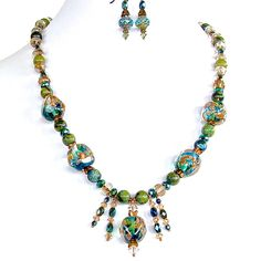 Dare to be mysterious in this unique necklace set of hand blown artisan lampwork beads, semi-precious Jasper, Czech glass and Swarovski crystal? http://earthandmoondesign.com/shop/etherea/guinevere-20-inch-blue-and-green-beaded-necklace-set/ $68