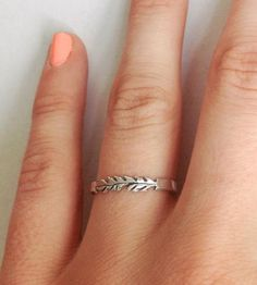 tiny silver feather ring.