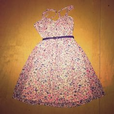 A floral, skinny strap dress with cup pads. Comes with the belt