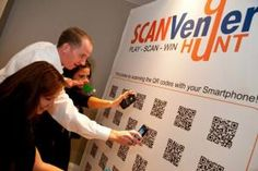 SCANVenger hunts are played using QR codes that can be placed throughout a venue, in an exhibit hall, or among a few city blocks. Players scan the codes and answer questions to earn points. Questions can be customized, for example, to quiz players about content learned at the event. Participants can also view the leaderboard on their devices, adding to the competition. SCANVenger also offers an interactive game wall—an 8- by 10-foot display of 30 QR codes