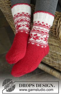 "Merry & Warm - DROPS Christmas: Knitted DROPS socks with Norwegian pattern in ""Karisma"". DROPS design: Pattern no u-751 Yarn group B - Free pattern by DROPS Design"