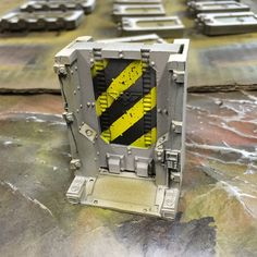 Hello, A good Zone Mortalis battleboard is nothing without a few chevron-patterned doors. Here is the quick step-by-step guide I followed to paint the chevron-patterned doors of my Zone Mortalis ba…