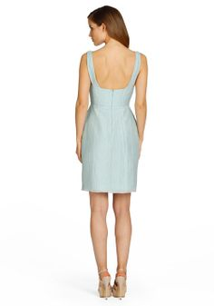 Back View  Celadon textured linen sheath bridesmaid dress, bateau neckline with natural waist, pockets at side.