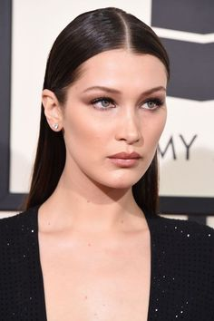 The Best Beauty Looks At The 2016 Grammy Awards #refinery29  http://www.refinery29.com/2016/02/103293/best-makeup-hair-grammy-awards-2016#slide-5  Bella Hadid The model took a break from NYFW to grace us with her gorgeousness on the Grammys red carpet and she looks like she just stepped off the runway. Her sleek wet-look hair, her soft smoky eye, and killer cheekbones just scream supermodel....