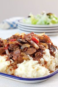 Paula Deen's Slow-Cooker Swiss Steak...serve over mashed potatoes for a yummy dinner!!