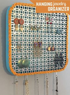 Learn how to make a hanging jewelry organizer from a basic wooden tray for less than $20! Head over to the blog for the how-to >> http://blog.hgtv.com/design/2015/07/01/how-to-turn-a-tray-into-a-diy-hanging-jewelry-organizer/?soc=pinterest
