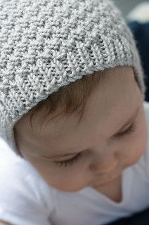 Modern Baby Bonnet pattern by Hadley Fierlinger. Free knitting pattern.