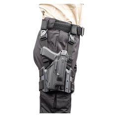 The Epoch Level 3 light-bearing duty holster has a passive retention detent screw. Has the EPOCH auto lock thumb release and fits popular lights. Blackhawk Tactical, Tactical Holster, Tactical Gear, 9mm Holster, Holsters, Airsoft Sniper, Airsoft Guns, Tactical Operator, Military Gear