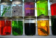 eco-friendly halloween decorations mad scientist lab. Use Mason jars or upcycled pickle, olive and baby food jars to create a mad scientist tablescape. Toss food, animals toys or other strange objects into the jars, fill with water and non-toxic food coloring, and you'll have a shelf full of freakish Halloween experiments.