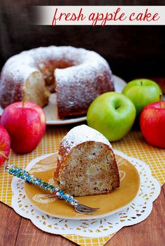 Spiced with cinnamon and studded with fresh apple pieces, this cake contains a secret ingredient that makes each wonderful slice over-the-top moist and apple-y: applesauce | iowagirleats.com