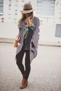 Black and white cardigan, tan cowboy hat, teal statement pendent, black skinny jeans, brown booties.