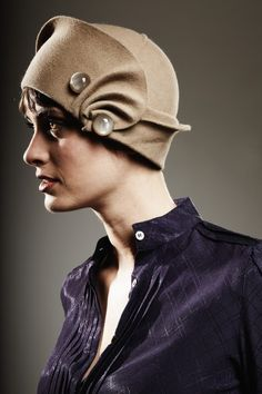 I just love hats: especially the ones that look like Roman Helmets. But where's the red brush like thingy' that goes on top?