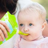 I'm feeding bailey yogurt from her Little Green Pouch, using the Boon Spoon attachment
