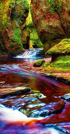 Red river through a gorge in Finnich Glen (The Devil's Pulpit).  The river turns red because of the red rock residue.  Amazing!! Click through to see 28 mind blowing photos of Scotland!