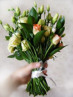 Fresh hand-tied bridal bouquet with eustoma and roses