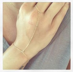 A personal favorite from my Etsy shop https://www.etsy.com/listing/208029974/dainty-gold-hand-chain