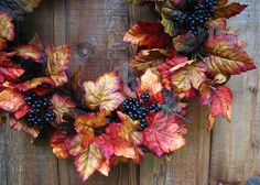 I love this wreath - red/gold leaves and deep purple berries