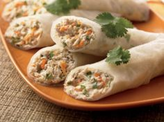 Tuna Rice-Paper Wraps.. An Asian-flavored tuna mix tucked into rice paper wrappers takes roll-ups to a whole new level of fun!