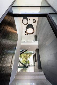Architecture: Modern Stone Wall And Wooden Door Staircase Modern Pendant Lights White Tile Texture Flooring Tempered Glass White Ceiling: Family House - Timeless Luxury House Gathering Waterside Panoramas Cabinet D Architecture, Interior Architecture, Interior And Exterior, Home Design, Australian Homes, Contemporary Interior Design, Minimalist Home, Luxury Homes, Building A House