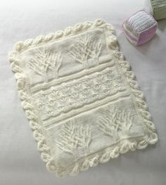 Create a beautiful and unique knit baby blanket with this Tree of Life Throw pattern.  The distinctive cabled tree pattern gives this blanket a whimsical look that makes it a perfect addition to a nursery.