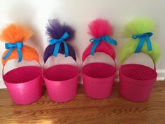 Planning a Trolls-themed birthday party? Follow these 4 simple steps to create inexpensive Trolls-themed snack baskets for your child's birthday party.