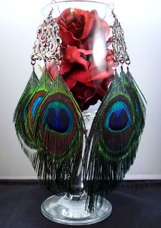 Large peacock feather earrings black.