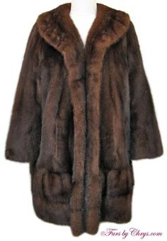 SOLD! Vintage Mahogany Mink Coat #MM694; Very Good Condition; Size range: 10 - 14 Misses or Petite. This is a gorgeous vintage genuine natural mahogany mink fur coat in the versatile stroller length. The bottom hemline has has two rows of horizontally sewn pelts with a subtle ruffle, as well as a slight ruffle on the collar -- very chic! This mahogany mink coat is a high quality fashion find! When you're going for that unique luxurious vintage look, this is the fur for you! You'll love it!