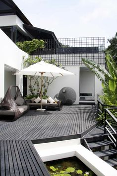 Terrace design - make the terrace look fancier . modern terrace design elegantly unusual outdoor furniture parasol In modern cities, it is almost impossible to sit down . Terrasse Design, Patio Design, Exterior Design, House Design, Modern Garden Design, Landscape Design, Modern Patio, Outdoor Spaces, Outdoor Living