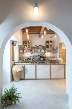 The careful selection of materials and elements in this cafe, such as the traditional mosaic floor, the white marble from the island of Naxos, the built-in benches and the wooden ceiling which was carefully restored and preserved, are familiar images tied to Greek island houses. #ModernCafe #CafeInterior #CafeDesign #InteriorDesign #Greece