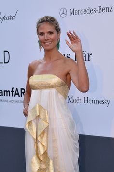 At Cannes: Heidi Klum was a head turner in a Marchesa dress. She teamed her look with emerald danglers.