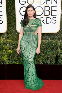 Trace Lysette looked like an absolute bombshell in a figure-hugging emerald green gown. She kept everything else simple as to not pull attention away from the intricate detailing. (Photo by Venturelli/WireImage)  via @AOL_Lifestyle Read more: http://www.aol.com/article/entertainment/2017/01/08/golden-globes-2017-red-carpet-arrivals/21650423/?a_dgi=aolshare_pinterest#fullscreen