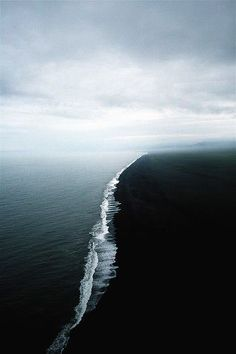 I love the contrast of this image. It captures the light and dark and the vastness of the ocean.