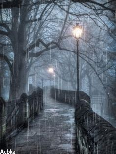 Walkway bridge and street light in the rain gif