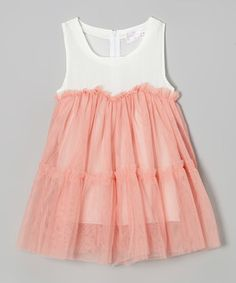 Bet this would be an easy diy. Dressed with a gorgeous, gauzy overlay, this frilly frock mixes playtime perfection with couture charm. Its soft, swinging silhouette will keep little darlings comfy until the day's end.