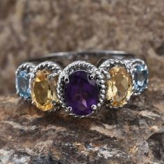 Look stunning and captivating with this amethyst and Brazilian citrine ring that will enhance your look. Embellished with sky blue topaz, the magnificent beauty is crafted in stainless steel. Coordinate this fashion accessory with your favorite outfit and step out in style.  Fee Shipping Gift Box