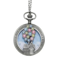 """<div>This pocket watch necklace from Disney's <i>Up </i>is here to remind you that every time you check the clock could be a moment for adventure. Burnished silver tone chain necklace with a pocket watch pendant featuring Carl Fredrickson's house die cut with pearlized pastel """"balloons"""" and text design that proclaims """"Adventure Is Out There."""" Carl's flying house in the middle of a cloudy sky is the image on the watch's face...."""