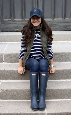 Olive green quilted vest, hunter rain boots and a southern proper hat makes for a comfy, casual look perfect for fall!