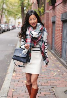 Classic Fall casual outfit: wool skirt, striped tee, tartan blanket scarf, leather brown riding boots