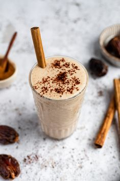 Creamy snickerdoodle tahini date smoothie made in just 10 minutes with no banana! This delicious, vegan date smoothie has Medjool dates, almond milk, cauliflower, tahini, vanilla and cinnamon for a wonderful flavor that tastes just like your favorite snickerdoodle cookie. Options to add extra protein and your favorite mix-ins. #tahini #dates #smoothie #dairyfree #vegan #vegansmoothie #cauliflower #breakfast #snack